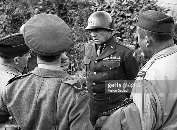 American General George S Patton talks to Allied war correspondents in Normandy France in 1944