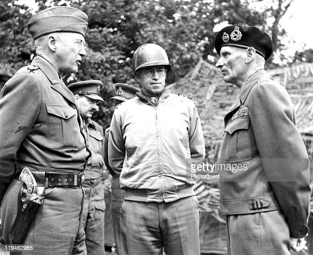 American Generals George S Patton and Omar Bradley speak with British General Bernard Law Montgomery July 7 1944