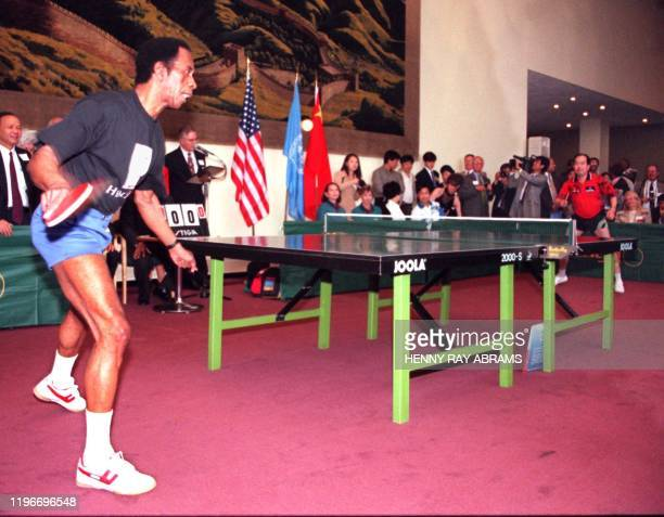 American George Brathwaite returns a shot to China's Liang Geliang 24 July at the United Nations in New York during an exhibition match celebrating...