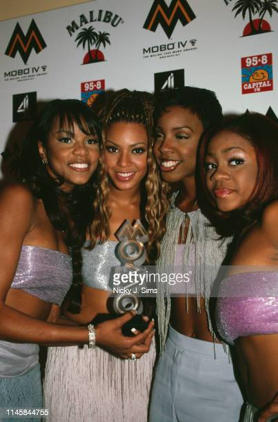 American girl group Destiny's Child with their MOBO Award for Best International R&B Act, at the Royal Albert Hall, London, 6th October 1999. Left to...