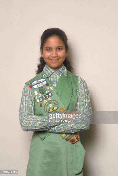 American Girl Scout cookie top seller Markita Andrews poses in her Girl Scout uniform with her arms crossed New York March 1985