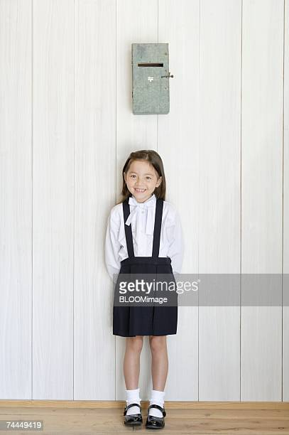 American girl smiling under post