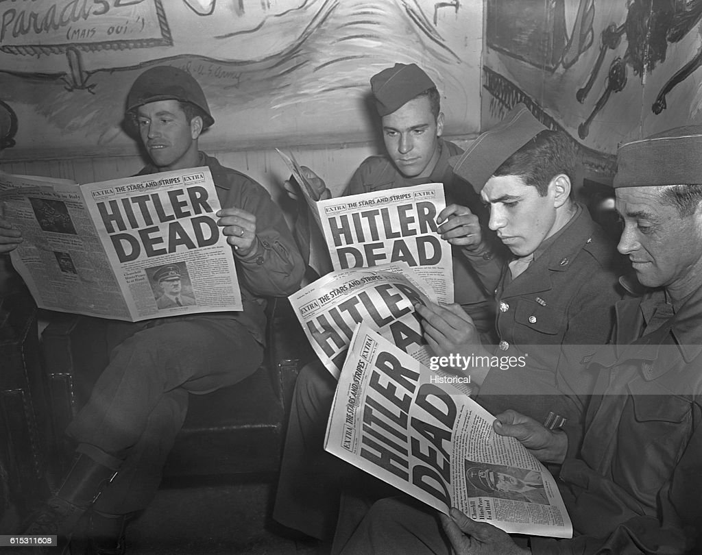American GIs Reading News of Hitler's Death : News Photo