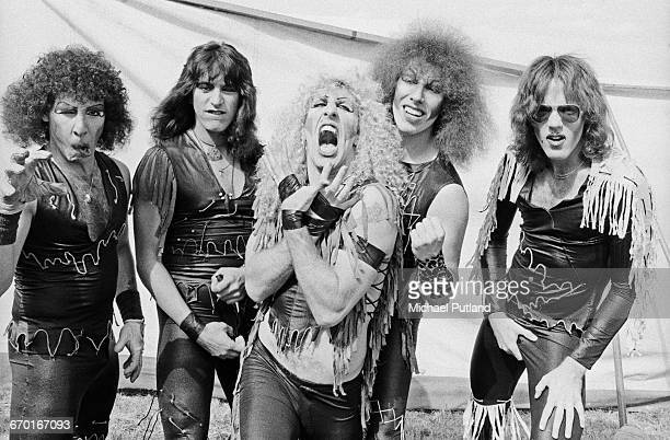 American glam metal group Twisted Sister backstage at the Reading Festival 29th August 1982 Left to right drummer AJ Pero guitarist Eddie Ojeda...