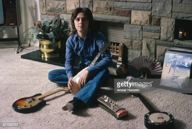 American glam rock singer and bassist Suzi Quatro with a collection of string instruments circa 1975 On the right is a copy of ZZ Top's album 'Tejas'