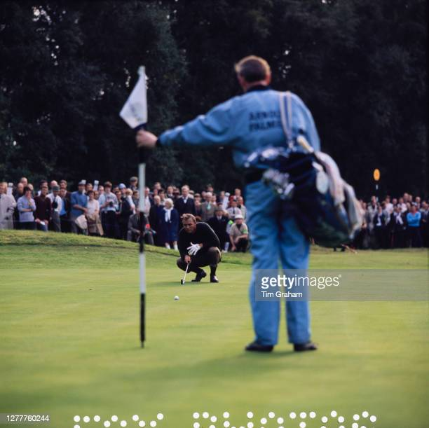 American golfer Arnold Palmer lines up a shot at Wentworth golf course, UK, October 1968.