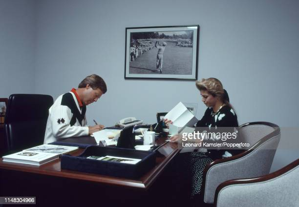 American golfer Ben Crenshaw in his offce with his wife Julie at home in Austin Texas circa 1989