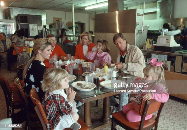 American golfer Ben Crenshaw with his family and friends having breakfast at Cisco's Bakery in Austin Texas circa 1989