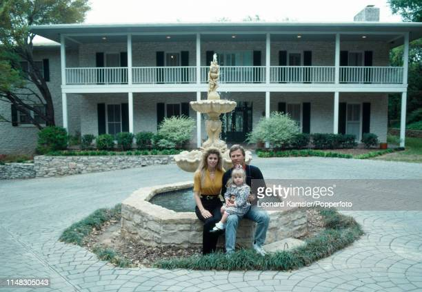 American golfer Ben Crenshaw with his wife Julie and daughter Katherine in front of their home in Austin Texas circa 1989