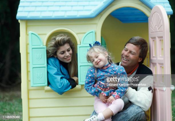 American golfer Ben Crenshaw with his wife Julie and daughter Katherine in Katherine's play house in Austin Texas circa 1989