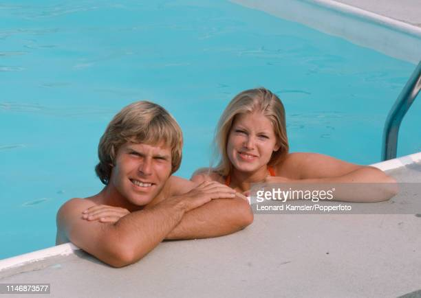 American golfer Ben Crenshaw with his wife Polly in a swimming pool circa 1976