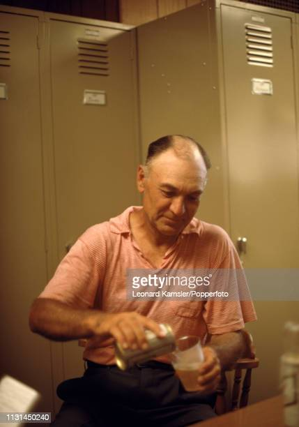 American golfer Ben Hogan pouring a beer in the locker room during the US Open at the Baltusrol Golf Club in Springfield New Jersey circa June 1967