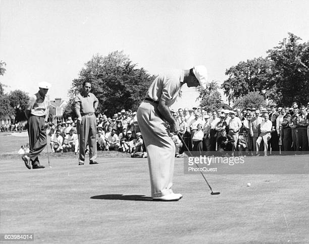 American golfer Ben Hogan putts on the second green as he defends his title during the second day's play at the US Open Birmingham Michigan June 15...