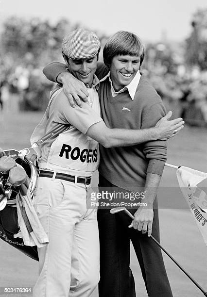 American golfer Bill Rogers celebrates on the 18th green with his caddie after winning the British Open Championship held at Royal St George's...