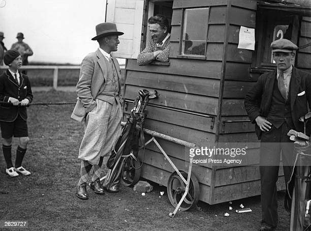 American golfer Bobby Jones chats to Jim Alexander the Old Course starter during the British Open Golf Championship at St Andrews Jones won the...