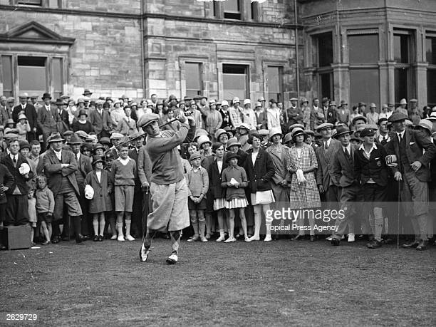 American golfer Bobby Jones drives off from the first tee during a practice game on the Old Course at St Andrews where the British Open Golf...
