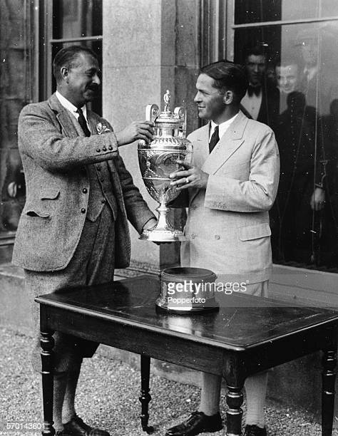 American golfer Bobby Jones is presented with the British Amateur Golf Trophy by Colonel Skine at St Andrews Scotland June 6th 1930