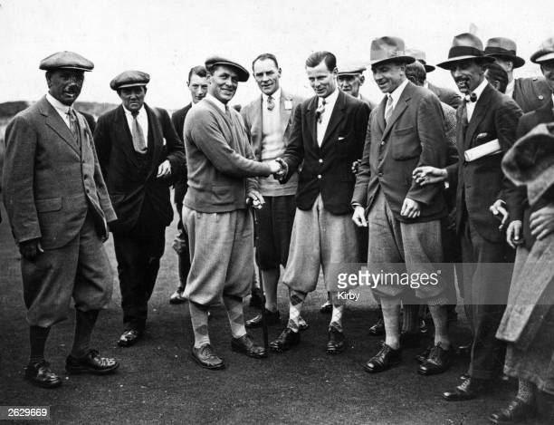 American golfer Bobby Jones shakes hands with the Scottish golfer Andrew Jamieson on the 15th Green after Jamieson won their match in the Amateur...