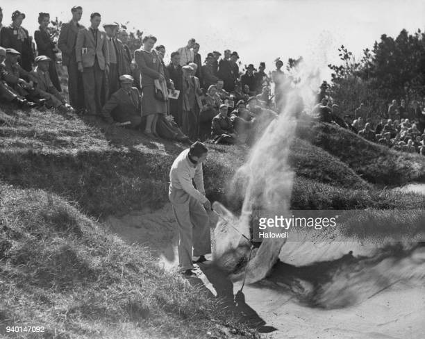 American golfer Charles Coe plays from a sand bunker approaching the 10th green during the Walker Cup Golf Tournament at Birkdale, UK, 11th May 1951.