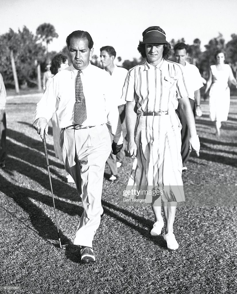 American golfer Claude Harmon (1916 - 1989) and Olympic athlete Babe Zaharias (1911 - 1956) walk together on the golf course at the Everglades Club during a game, Palm Beach, Florida, 1950.