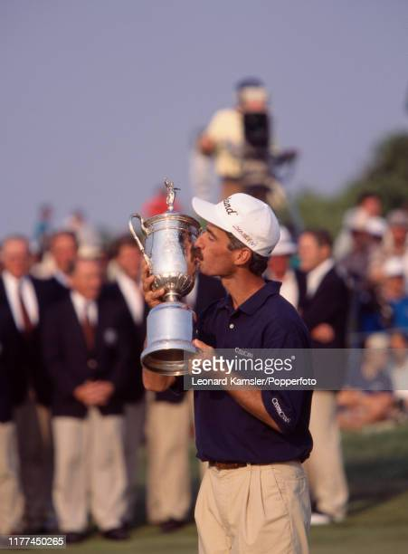 American golfer Corey Pavin kisses the trophy after winning the US Open Golf Championship at the Shinnecock Hills Golf Club in New York on 18th June...