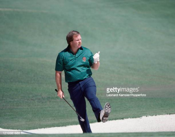 American golfer Craig Stadler reacts after playing out of a bunker during the US Masters Golf Tournament at the Augusta National Golf Club in...