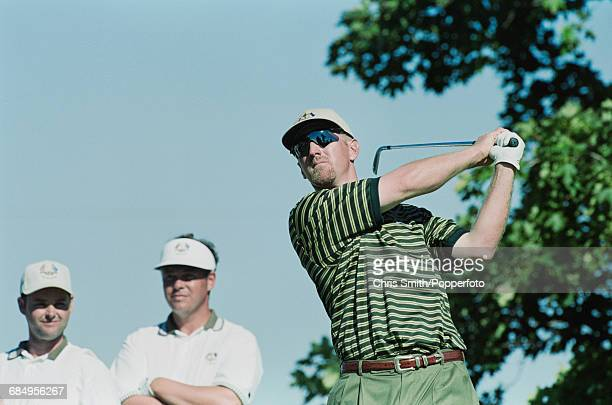 American golfer David Duval pictured in action playing a stroke for Team USA as Lee Westwood and Darren Clarke of Team Europe look on during play to...