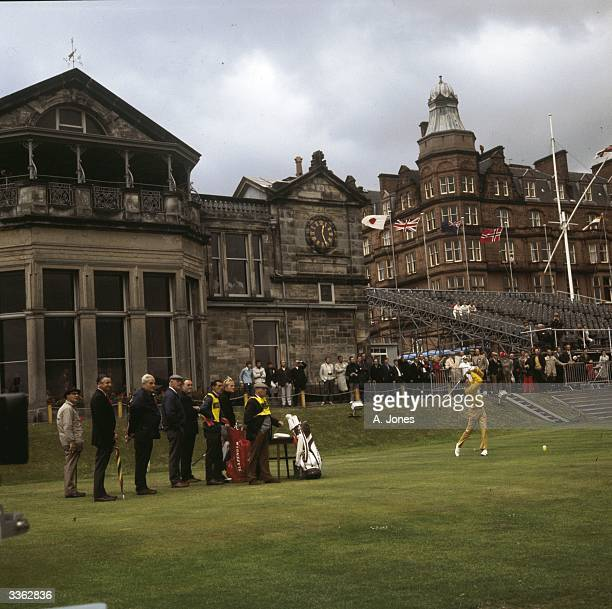 American golfer Doug Sanders teeing off in front of the famous clubhouse at St Andrews during the 1970 British Open which Jack Nicklaus won The Royal...