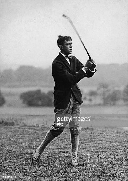American golfer Francis Ouimet holds his club as he watches his shot travel down the course, 1910s. Ouimet won the 1913 U.S. Open as 20-year-old...