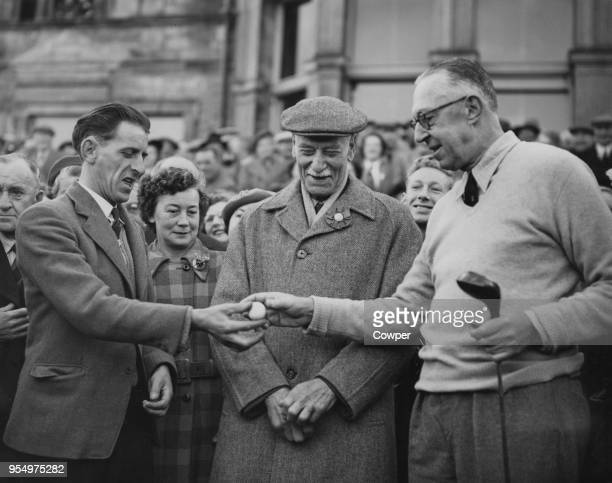 American golfer Francis Ouimet receives his first ball as Captain of the Royal and Ancient Golf Club of St Andrews, Scotland, from caddie Arthur...