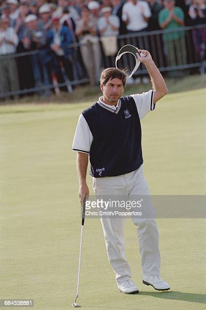 American golfer Fred Couples pictured raising his sun visor in the air during competition to finish in joint 66th place in the 1998 British Open...