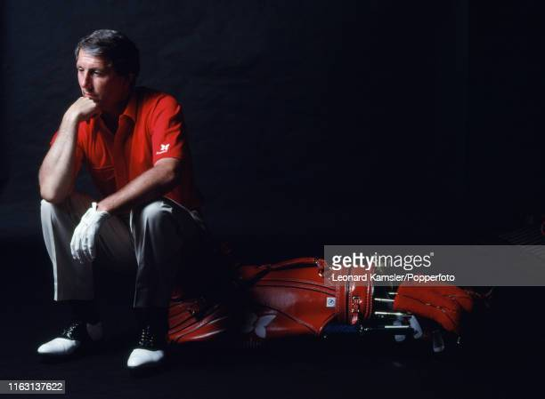 American golfer Hale Irwin sitting next to his golf bag and clubs circa 1991