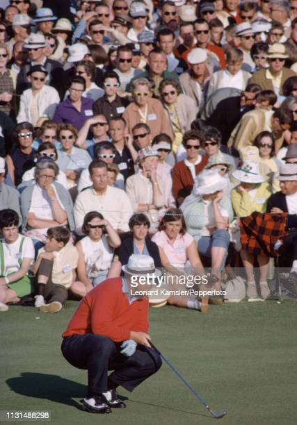 American golfer Jack Nicklaus lining up a putt on the 18th green during the US Masters Golf Tournament at the Augusta National Golf Club in Augusta...