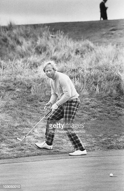 American golfer Jack Nicklaus sinks his putt for an eagle three on the 6th green during The Open Championship at the Royal Troon Golf Club Scotland...
