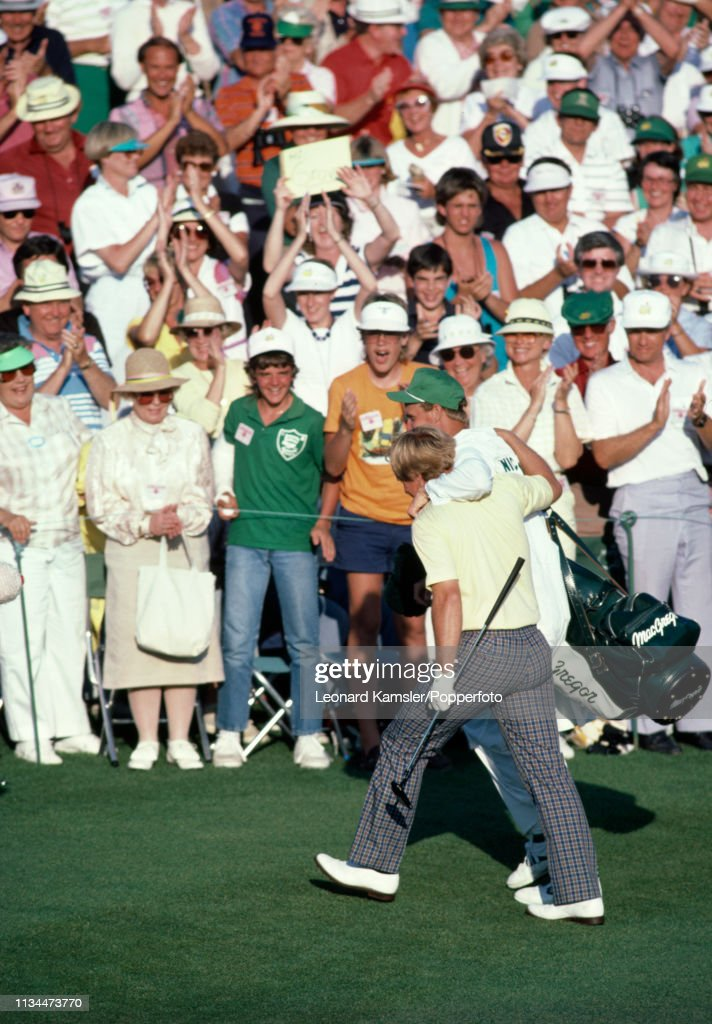 American golfer Jack Nicklaus with his caddy and son Jackie