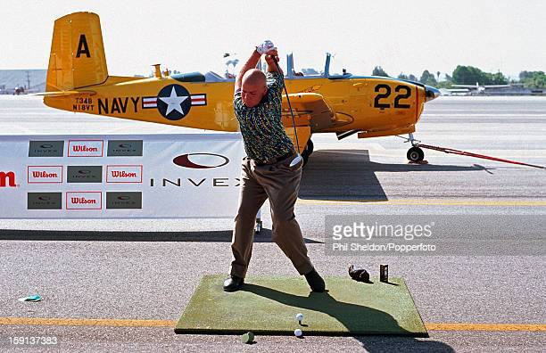 American golfer John Daly attempting a long distance golf driving record at Santa Monica airport in the USA 1995