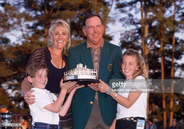American golfer Mark O'Meara wearing his Green Jacket with the trophy and his family wife Alicia son Shaun and daughter Michelle following the...