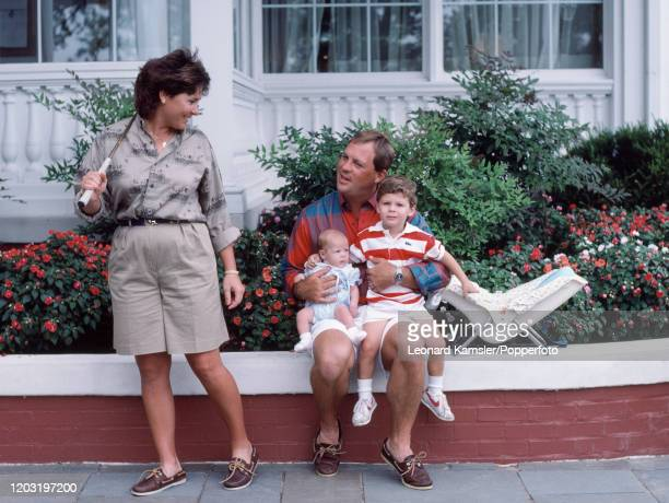 American golfer Myra Blackwelder carrying a golf club with her family husband Worth baby daughter Mallory and son Myles at their home in Lexington...
