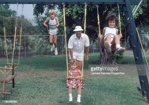 American golfer Raymond Floyd with his children on their swing set left to right Raymond Junior Christina and Robert at home circa 1981