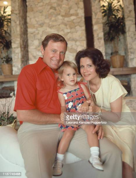 American golfer Raymond Floyd with his wife Maria and daughter Christina at home circa 1981