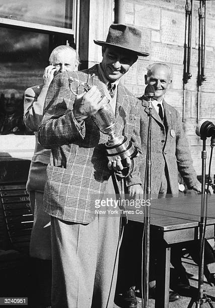 American golfer Sam Snead holding the British Open Golf Championship trophy after he won St Andrews Scotland