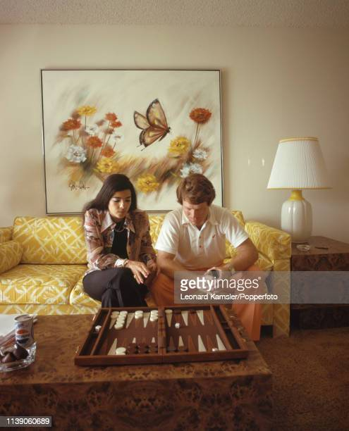 American golfer Tom Watson playing backgammon at home with his wife Linda circa 1976