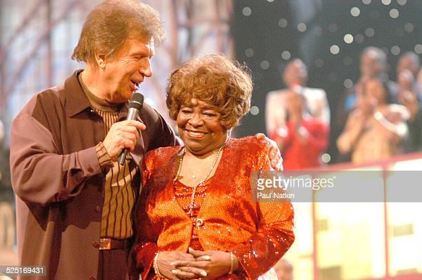 American gospel musician Bill Gaither and Albertina Walker perform, Dallas, Texas, March 11, 2003.