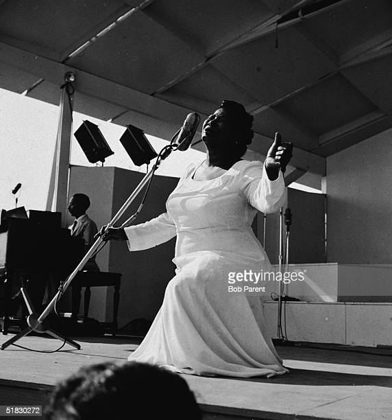 American gospel singer Mahalia Jackson sings on bended knee with her arms outstretched at the Newport Jazz Festival Newport Rhode Island July 7 1957