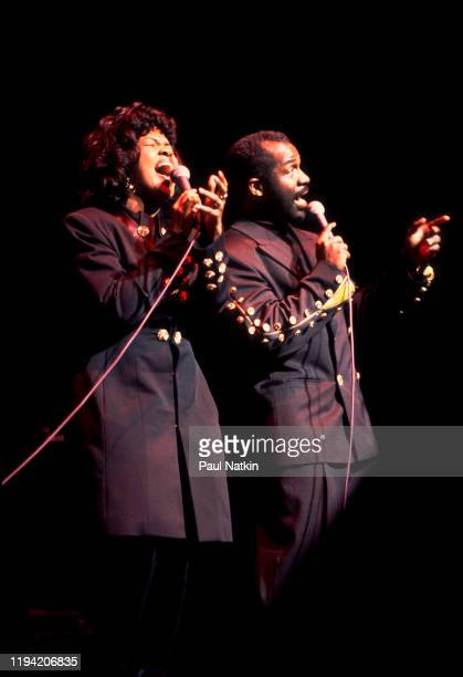 American Gospel singers BeBe and CeCe Winans perform onstage at the Aire Crown Theater Chicago Illinois February 12 1995