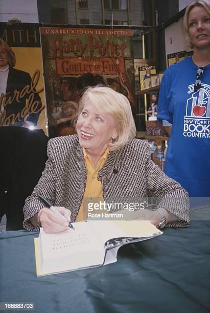 American gossip columnist Liz Smith signs copies of her memoir 'Natural Blonde' on Fifth Avenue New York City 2000