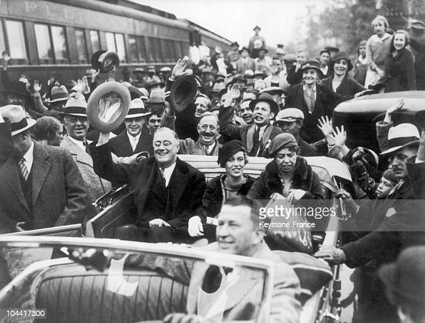 American governor Franklin D ROOSEVELT his wife Eleanor and their daughter Anna being acclaimed by the crowds while campaigning for the presidential...