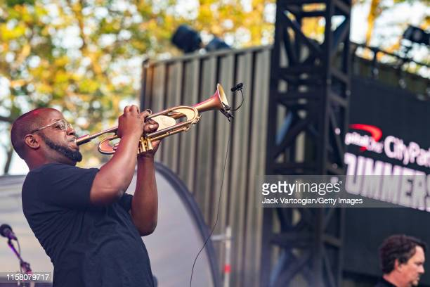 American guest musician Eric Gordon plays trumpet as he performs onstage with the jam band Galactic at Central Park SummerStage New York New York...
