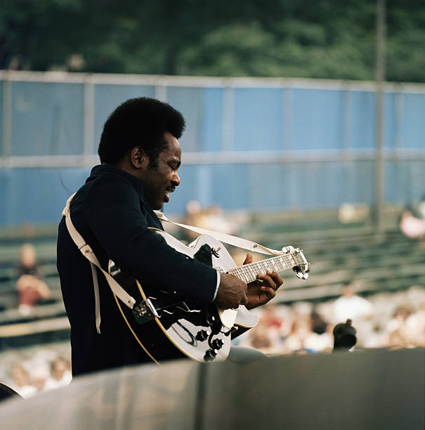 American guitar player George Benson performs on stage...