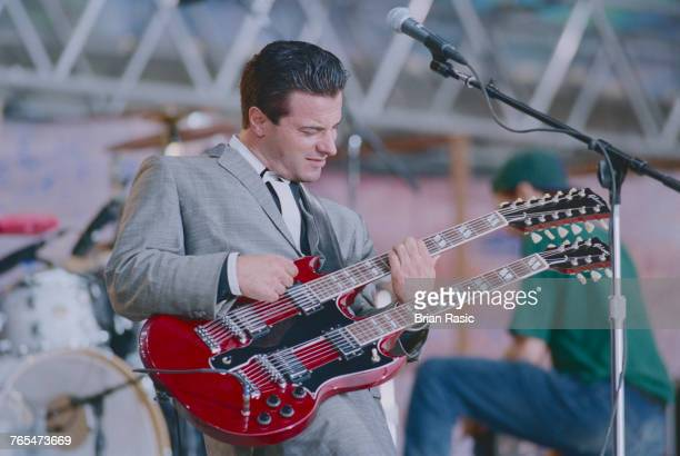 American guitarist and musician Peter DiStefano performs live on stage with Porno for Pyros at the Woodstock '94 festival at Winston Farm in...